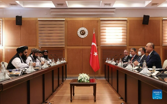 Turkish Foreign Minister Mevlut Cavusoglu (1st R) meets with Afghanistan's acting Foreign Minister Amir Khan Muttaqi (1st L) in Ankara, Turkey, on Oct. 14, 2021. Turkish Foreign Minister Mevlut Cavusoglu on Thursday met with a senior delegation of Taliban from Afghanistan, the first meeting of its kind since the group took power in August. (Photo by Mustafa Kaya/Xinhua)