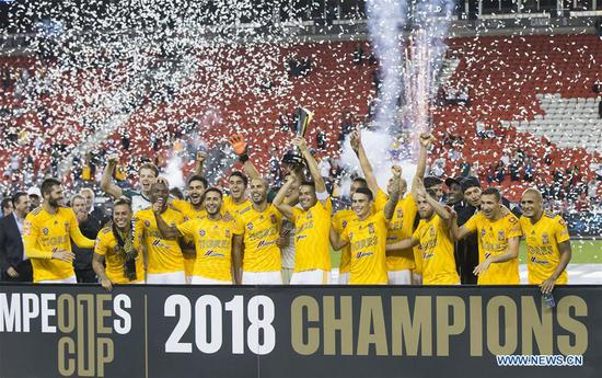 Players of Mexico's Tigres UANL celebrate victory with trophy during the awarding ceremony of the inaugural Campeones Cup match between Canada's Toronto FC and Mexico's Tigres UANL at BMO Field in Toronto, Canada, Sept. 19, 2018. Mexico's Tigres UANL won 3-1 and claimed the title. The Campeones Cup, established in 2018, is an annual North American soccer competition contested between the champions of the previous Major League Soccer season and the winner from Liga MX. (Xinhua/Zou Zheng)