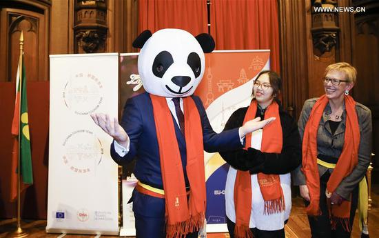 Mayor of Brussels Philippe Close dressed up as a giant panda attends a reception of a Chinese lantern exhibition in Brussels, Belgium, on Feb. 22, 2018, to celebrate the Chinese Lunar New Year and the EU-China Tourism Year. (Xinhua/Ye Pingfan)