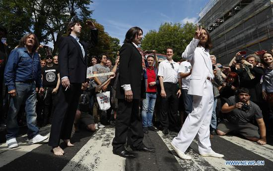 Beatles impersonators recreate the iconic album cover of