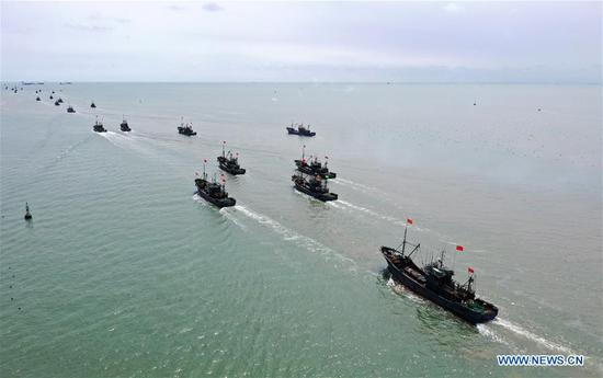 Aerial photo taken on Sept. 1, 2019 shows boats setting sail for fishing in Rizhao, east China's Shandong Province. The annual summer fishing ban, which was enforced on May 1 in the Yellow Sea and Bohai Sea, took an end on Sunday. (Xinhua/Wang Kai)