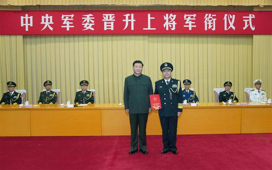 Xi Jinping, chairman of the Central Military Commission (CMC), presents a certificate of order at a ceremony to promote Xu Zhongbo, political commissar of the Rocket Force of the Chinese People's Liberation Army, to the rank of general, in Beijing, capital of China, July 29, 2020. The ceremony was held by the CMC in Beijing. (Xinhua/Li Gang)