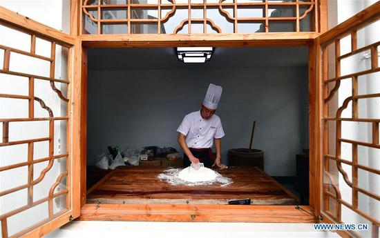 Zhang Xu makes mooncake crust with malt sugar syrup and flour at the mooncake bakery Jingshengchang in Xiayi County, Shangqiu, central China's Henan Province, Sept. 13, 2020. At age 31, Zhang Xu already serves as the chef of Jingshengchang, a Henan-based mooncake bakery established in 1860. Mooncakes produced at Jingshengchang are characterized by their crispy crusts and generous stuffing, coupled with a meticulous set of bakery skills which Zhang had begun to learn since high school graduation in 2007.