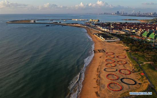 Aerial photo taken on Sept. 28, 2020 shows a seaside view of Rizhao City, east China's Shandong Province. China is set to welcome eight days of national holiday this year as the Mid-Autumn Festival coincide with the country's National Day. (Xinhua/Fan Changguo)
