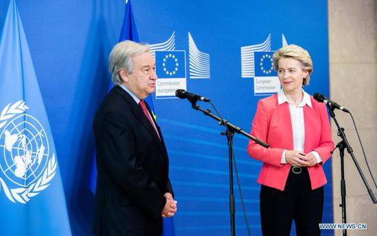 """United Nations (UN) Secretary-General Antonio Guterres (L) delivers a speech to the press as he visits the European Commission in Brussels, Belgium, June 23, 2021. Antonio Guterres asked the European Union (EU) to fight for values of """"enlightenment"""" against populism, racism and other intolerant ideas during his visit here on Wednesday. (European Union/Handout via Xinhua)"""