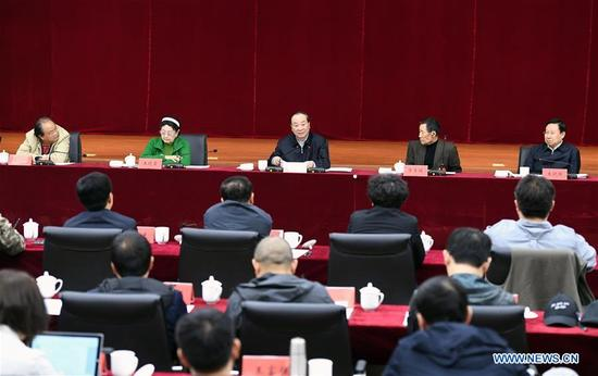 Huang Kunming, member of the Political Bureau of the Communist Party of China (CPC) Central Committee and head of the Publicity Department of the CPC Central Committee, presides over a symposium on filmmaking in Beijing, capital of China, April 13, 2018. (Xinhua/Zhang Ling)