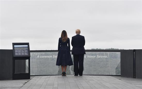 US President Donald Trump and First Lady Melania Trump arrive on September 11, 2018, to speak at the site of a new memorial in Shanksville, Pennsylvania where Flight 93 crashed during the September 11 attacks, as somber ceremonies take place at Ground Zero in New York and at the Pentagon.
