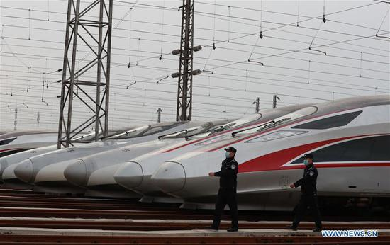 Photo taken on April 6, 2020 shows bullet trains at a depot in Wuhan, central China's Hubei Province. The central Chinese city of Wuhan, once the epicenter of the novel coronavirus outbreak, will resume operation of nearly 100 passenger trains starting April 8, according to the local railway operator. Trains have started arriving in 17 stations in Wuhan since March 28, and outbound trains will start to resume services on April 8, according to local authorities. (Photo by Zhao Jun/Xinhua)