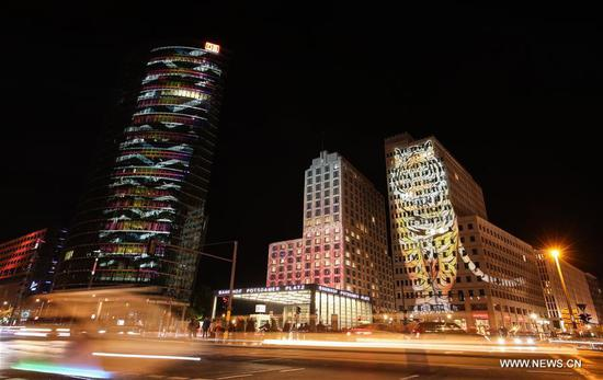 Illuminated buildings are seen at Potsdamer Platz during the 2018 Festival of Lights in Berlin, capital of Germany, on Oct. 5, 2018. Berlin turned into a city of light art with the opening of its Festival of Lights on Friday which will last from Oct. 5 to Oct. 14. (Xinhua/Shan Yuqi)