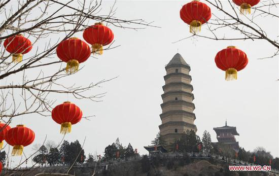 Photo taken on Jan. 29, 2019 shows the Pagoda Hill tourist spot decorated with red lanterns for the upcoming Spring Festival in Yan'an City, northwest China's Shaanxi Province. The Spring Festival, or the Chinese Lunar New Year, falls on Feb. 5 this year. (Xinhua/Wang Fujian)