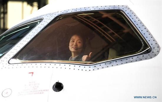 Jiang Dandan is seen in the cockpit of a flight-testing aircraft in Yanliang District of Xi'an, capital of northwest China's Shaanxi Province, on March 5, 2019. Jiang Dandan, 29, is one of the youngest test pilots in China and the only female test pilot for commercial transport aircrafts currently being trained at the Aviation Industry Corporation of China, Ltd. She went through dozens of professional courses and 750 hours of flying practice in six years. At the end of 2017, she became a test pilot and participated in the test flights during the research and development of ARJ21-700, C919 and other types of aircrafts. (Xinhua/Liu Xiao)