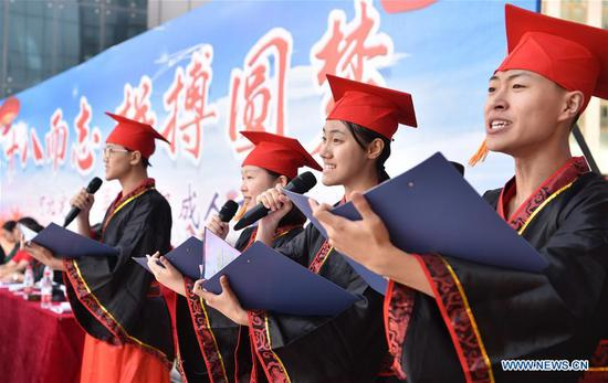 Students wearing traditional Chinese costumes take part in a collective coming-of-age ceremony at the Dingzhou Middle School in Dingzhou, north China's Hebei Province, Sept. 16, 2019. (Xinhua/Zhu Xudong)