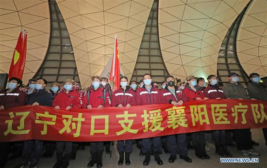 Medical team members take a group photo before leaving for Hubei Province at Shenyang Taoxian International Airport in Shenyang, capital of northeast China's Liaoning Province, Feb. 12, 2020. A medical team comprised of 115 medical personnel from Liaoning Province set off on Wednesday at Shenyang Taoxian International Airport to aid the coronavirus control efforts in Hubei. Among them, 32 medical workers will head for Wuhan, and the other 83 will leave for Xiangyang as the first medical team from Liaoning Province to aid the novel coronavirus control efforts there. (Xinhua/Yang Qing)