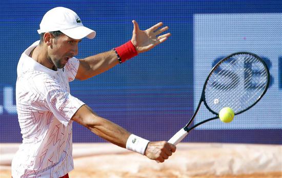 Novak Djokovic of Serbia returns to Alexander Zverev of Germany during their match at the tennis tournament Adria Tour in Belgrade, Serbia on June 14, 2020. (Xinhua/Predrag Milosavljevic)