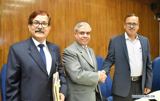 Kazi Shofiqul Azam(R), secretary of Bangladeshi Economic Relations Division, shakes hands with Manmohan Parkash(2nd L), country director of the Asian Development Bank (ADB), after signing agreements at a ceremony in Dhaka, Bangladesh on Sept. 10, 2018. The Asian Development Bank (ADB) and the government of Bangladesh Monday signed agreements for 350 million U.S. dollars in loan and 7.5 million U.S. dollars in grant for a project to develop two power lines in support of Bangladesh's national target of electricity for all by 2021. (Xinhua)