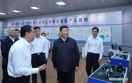 Chinese President Xi Jinping, also general secretary of the Communist Party of China Central Committee and chairman of the Central Military Commission, learns about the production process and operation of the JL MAG Rare-Earth Co. Ltd. as well as the development of the rare earth industry in the city of Ganzhou in east China's Jiangxi Province on May 20, 2019. Xi Jinping visited Jiangxi Province Monday on an inspection tour. (Xinhua/Ju Peng)