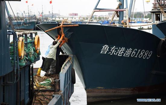 Fishermen prepare to leave the port for fishing in Rizhao, east China's Shandong Province, Sept. 1, 2019. The annual summer fishing ban, which was enforced on May 1 in the Yellow Sea and Bohai Sea, took an end on Sunday. (Xinhua/Wang Kai)