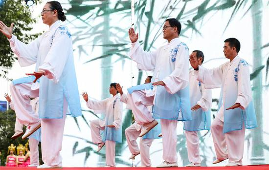 The elderly perform Tai Chi to celebrate Chongyang Festival on Gulou Square in Deyang, southwest China's Sichuan Province, Oct. 7, 2019. A series of events were held on Monday to celebrate Chongyang Festival, which falls on the ninth day of the ninth Chinese lunar month, a day to pay respect to seniors in China. (Xinhua/Jiang Hongjing)