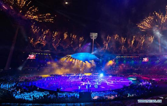 A figure in the shape of a white whale is seen and fireworks explode at the end of the opening ceremony of the 2018 Gold Coast Commonwealth Games at the Carrara Stadium in the Gold Coast, Australia, April 4, 2018. (Xinhua/Zhu Hongye)