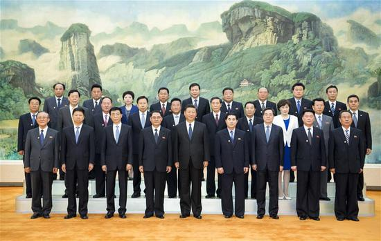Xi Jinping (C, front), general secretary of the Central Committee of the Communist Party of China (CPC) and Chinese president, meets with a friendship visiting group of the Workers' Party of Korea (WPK) of the Democratic People's Republic of Korea led by Pak Thae Song, member of the Political Bureau and vice-chairman of the WPK Central Committee, in Beijing, capital of China, May 16, 2018. (Xinhua/Li Xueren)