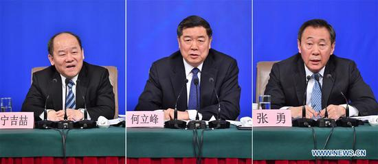 Combined photo shows He Lifeng (C), head of the National Development and Reform Commission (NDRC) , and deputy heads of the NDRC Zhang Yong (R) and Ning Jizhe, taking questions during a press conference on innovation and improvement of macro-economic control and promotion of high quality development during the first session of the 13th National People's Congress in Beijing, capital of China, March 6, 2018. (Xinhua/Li Xin)