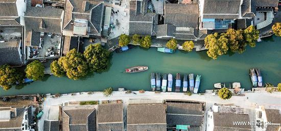 Tourists take sightseeing boats on the river in the ancient town of Zhouzhuang in Suzhou City, east China's Jiangsu Province, March 9, 2018. As temperature rises, the water town of Zhouzhuang becomes hot tourist destination. (Xinhua/Li Bo)