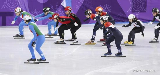 China's Han Yutong (5th L) and Zhou Yang (4th L) compete during the women's 3000m relay heat of short track speed skating event of 2018 PyeongChang Winter Olympic Games at Gangneung Ice Arena, South Korea, Feb. 10, 2018. China advanced to the final in a time of 4:05.315 and set a new Olympic record of the event. (Xinhua/Han Yan)