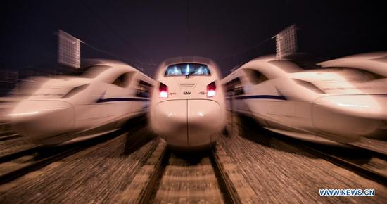 Bullet trains are seen in a station in Chengdu, southwest China's Sichuan Province, Dec. 1, 2017. High-speed trains linking Xi'an, capital of Shaanxi Province, and Chengdu, will begin operation on Dec. 6, authorities said Sunday. Tickets for the trains are available for purchase from 6 p.m. Sunday. (Xinhua/Xue Yubin)