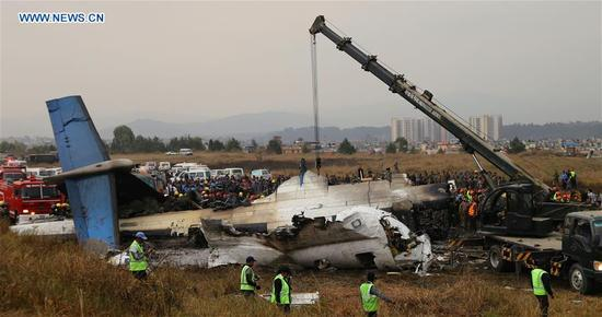 Photo taken on March 12, 2018 shows the plane crash site in Kathmandu, Nepal. At least 49 people were killed and 17 injured after a passenger plane of the US-Bangla Airlines crashed at Nepal's Tribhuvan International Airport (TIA) on Monday afternoon, authorities confirmed. (Xinhua/Sunil Sharma)
