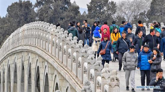 People enjoy their leisure time at the Summer Palace in Beijing, capital of China, March 11, 2018. (Xinhua/Li Xin)