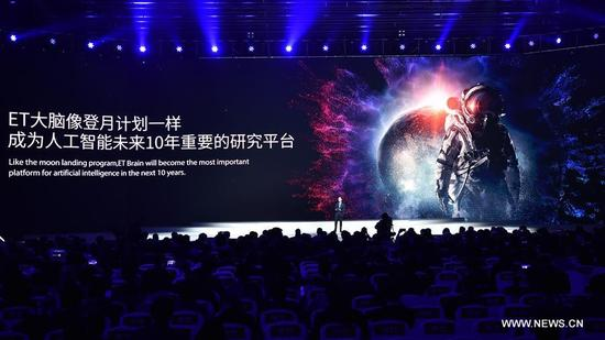 Zhang Yong, CEO of Alibaba, introduces its artificial intelligence (AI) ET Brain during the release ceremony for world leading Internet scientific and technological achievements in Wuzhen, east China's Zhejiang Province, Dec. 3, 2017. The Fourth World Internet Conference opened in Wuzhen on Sunday. (Xinhua/Li Xin)
