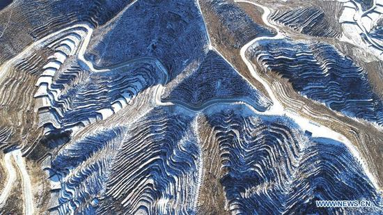 Photo taken on Jan. 8, 2018 shows scenery of terraced fields covered by snow in Shexian County, north China's Hebei Province. (Xinhua/Wang Xiao)