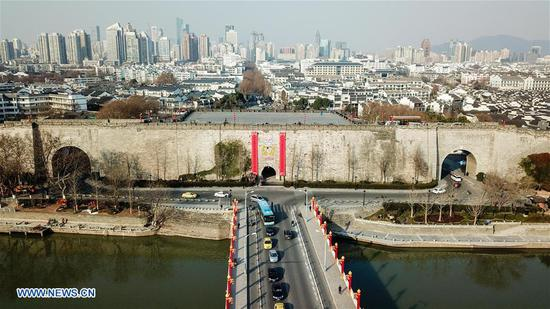 Aerial photo taken on Feb. 6, 2018 shows the Zhonghua Gate in Nanjing, capital city of east China's Jiangsu Province. Couplets with each approximately 15 meters high and 2 meters wide are hung on the 12 ancient city gates in Nanjing to welcome the coming Spring Festival which falls on Feb. 16. Hanging couplets on the door is a traditional way for Chinese to celebrate the Lunar New Year. (Xinhua/Li Bo)