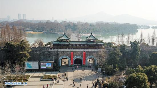 Aerial photo taken on Feb. 8, 2018 shows the Xuanwu Gate in Nanjing, capital city of east China's Jiangsu Province. Couplets with each approximately 15 meters high and 2 meters wide are hung on the 12 ancient city gates in Nanjing to welcome the coming Spring Festival which falls on Feb. 16. Hanging couplets on the door is a traditional way for Chinese to celebrate the Lunar New Year. (Xinhua/Li Bo)