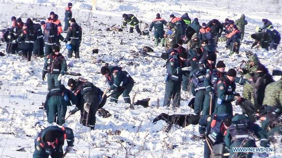 Screenshot from a video provided by Russian Emergencies Ministry on Feb. 12, 2018 shows Russian Emergencies Ministry officers working at the scene where the AN-148 passenger jet crashed on Feb. 11 in the Moscow region of Russia. Rescuers have presumably recovered the second flight data recorder of the AN-148 passenger jet that crashed in the Moscow region on Sunday, the Russian Emergencies Ministry said Monday. (Xinhua/Sputnik)