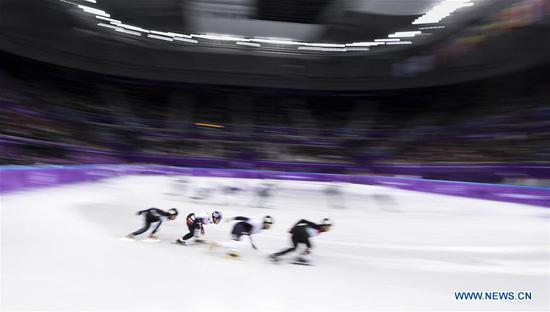 South Korea's athletes compete during men's 5000m relay heat event of short track speed skating at the Pyeongchang 2018 Winter Olympic Games at Gangneung Ice Arena, Gangneung, South Korea, Feb. 13, 2018. Team South Korea advanced to next round in a time of 6:34.510 and set a new Olympic record. (Xinhua/Han Yan)