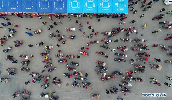 Migrant workers have a break at Xiaoxiang service station in Zhaoqing, south China's Guangdong Province, Feb. 7, 2018. Many migrant workers in China chose to go home by motorcycle for a family reunion in the Spring Festival, or Chinese traditional lunar New Year. (Xinhua/Liang Xu)