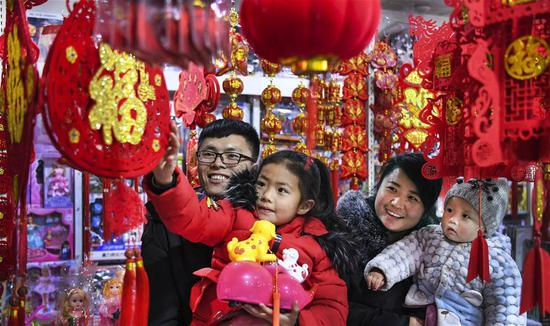 People select Spring Festival goods in Yulin City of northwest China's Shaanxi Province, on Feb. 7, 2018, one day before Xiaonian. Xiaonian falls on the 23rd or 24th day of the last month of the Chinese traditional lunar calendar, marking the start of the countdown to Spring Festival. (Xinhua/Tao Ming)