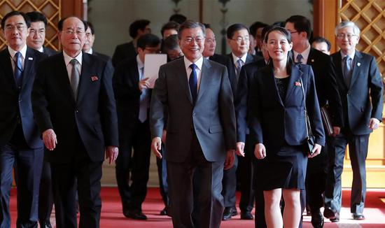 South Korean President Moon Jae-in (front C) walks with Kim Yong Nam (front L), president of the Presidium of the Supreme People's Assembly of the Democratic People's Republic of Korea (DPRK), and Kim Yo Jong (front R), the younger sister of top DPRK leader Kim Jong Un, at the Blue House in Seoul, capital of South Korea, on Feb. 10, 2018. (Xinhua/Newsis)
