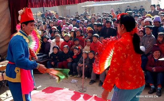 File photo taken on Feb. 6, 2003 shows a folk art troupe performing in Minjian Village of north China's Inner Mongolia Autonomous Region. In Chinese villages, people have their distinctive ways to celebrate the Spring Festival. Simple but joyful, the celebrations bring them gratification and happiness. Spring festival, or better known as Chinese Lunar New year, is the most important festival for all Chinese, which has a history of more than 4,000 years. It is an occasion for home returning, New Year goods preparing, celebrating, and foremost, family reunion. (Xinhua/Li Xin)