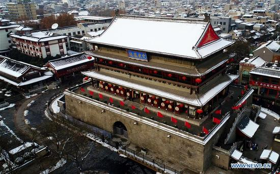 Aerial photo taken on Jan. 7, 2018 shows the Drum Tower after snow in Xi'an, capital of northwest China's Shaanxi Province. After days of rain and snow, Xi'an greeted sunny weather on Sunday. (Xinhua/Liu Xiao)