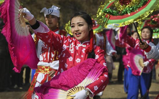 A rural folk dance team performs in Guojiagou Village, Suide County, Yulin City of northwest China's Shaanxi Province, on Feb. 8, 2018, the day of Xiaonian. Xiaonian falls on the 23rd or 24th day of the last month of the Chinese traditional lunar calendar, marking the start of the countdown to Spring Festival. (Xinhua/Tao Ming)