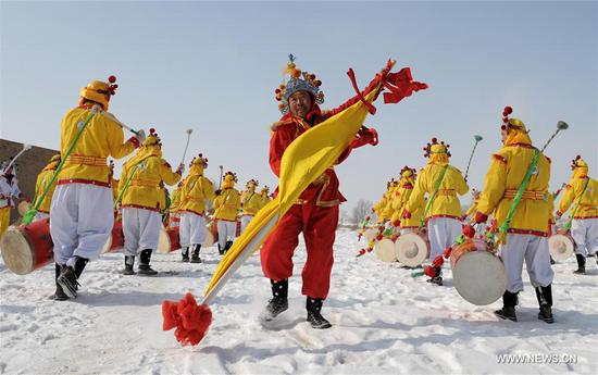 File photo taken on Feb. 2, 2008 shows people rehearsing Taiping Drum Dance to greet the Spring Festival in Huojiawan Village, northwest China's Gansu Province. In Chinese villages, people have their distinctive ways to celebrate the Spring Festival. Simple but joyful, the celebrations bring them gratification and happiness. Spring festival, or better known as Chinese Lunar New year, is the most important festival for all Chinese, which has a history of more than 4,000 years. It is an occasion for home returning, New Year goods preparing, celebrating, and foremost, family reunion. (Xinhua/Han Chuanhao)