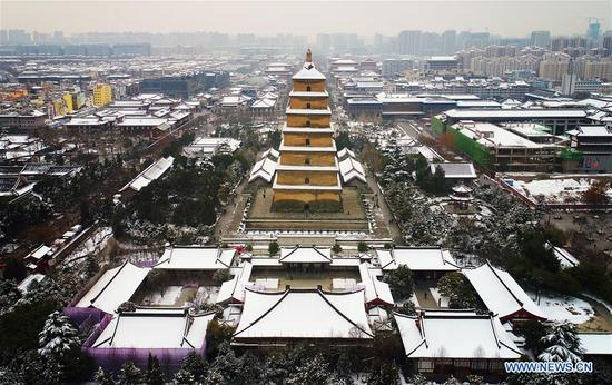 Aerial photo taken on Jan. 7, 2018 shows the Dayan Pagoda after snow in Xi'an, capital of northwest China's Shaanxi Province. After days of rain and snow, Xi'an greeted sunny weather on Sunday. (Xinhua/Liu Xiao)