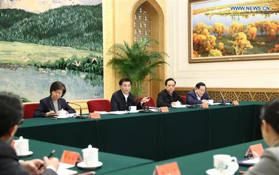 Wang Huning (back, 3rd R), a member of the Standing Committee of the Political Bureau of the Communist Party of China Central Committee, speaks at a meeting attended by leaders of five mass organizations, namely the All-China Federation of Trade Unions, the Communist Youth League Central Committee, All-China Women's Federation, China Association for Science and Technology, and All-China Federation of Returned Overseas Chinese, in Beijing, capital of China, Jan. 13, 2018. (Xinhua/Ju Peng)
