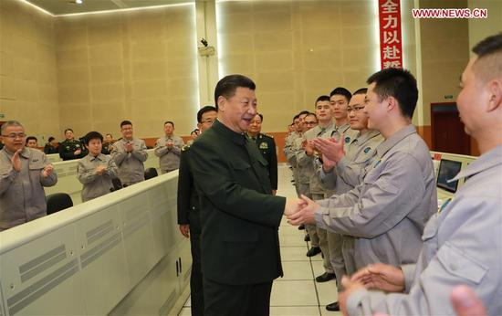 Chinese President Xi Jinping (L, front), also general secretary of the Communist Party of China Central Committee and chairman of the Central Military Commission, talks with scientists and technicians, asking them about their research, work and lives, as he visits a military base in southwest China's Sichuan Province, Feb. 10, 2018. Xi extended festival greetings to all officers and soldiers of the People's Liberation Army and the armed police force, and all militia and reserve personnel. (Xinhua/Li Gang)