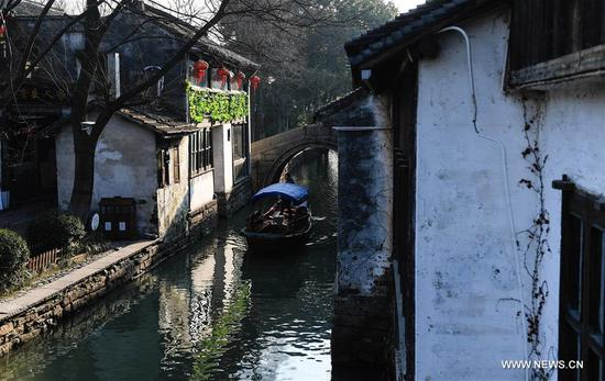 Tourists take sightseeing boats on the river in the ancient town of Zhouzhuang in Suzhou City, east China's Jiangsu Province, March 9, 2018. As temperature rises, the water town of Zhouzhuang becomes hot tourist destination. (Xinhua/Ji Chunpeng)