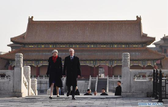 UK Prime Minister Theresa May and her husband Philip May visit the Palace Museum, or the Forbidden City, in Beijing, the capital of China, on Feb. 1, 2018. Theresa May, on Jan. 31, praised China's fast-growing economy for helping UK businesses, saying,