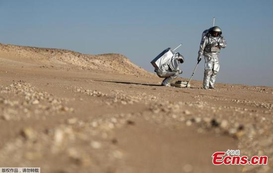 Astronauts are spending a month in isolation on a simulated 'red planet' in the desolate Dhofar desert in Oman to help prepare humanity for a future mission to Mars. Using a drone, robotic rovers and an inflatable greenhouse, the astronauts will carry out 19 experiments on this baron area, picked for its resemblance to Mars. Seen from space, the Dhofar Desert is a flat, brown expanse and few animals or plants survive its temperatures that can top 125 degrees Fahrenheit, or 51 degrees Celsius. On the eastern edge of a seemingly endless dune is the Oman Mars Base is a giant 2.4-ton inflated habitat surrounded by shipping containers turned into labs and crew quarters. More than 200 scientists from 25 nations have chosen it as their location to field-test technology for a manned mission to the red planet which Nasa hopes to achieve by the 2030s. (Photo/Agencies)