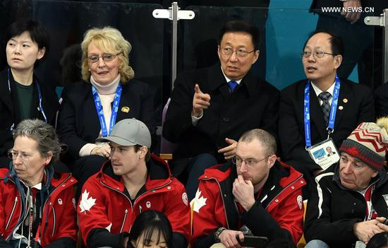 Chinese President Xi Jinping's special envoy Han Zheng, also a member of the Standing Committee of the Political Bureau of the Communist Party of China Central Committee, watches a curling event in Gangneung Curling Centre, South Korea, Feb. 9, 2018. (Xinhua/Ma Ping)